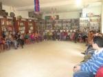 children and facilitators listen to the dr axplanation